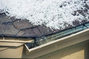 how are roofs damaged by hail